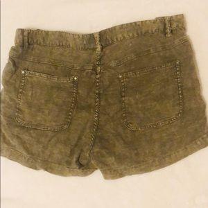 Free People Shorts - Free People dark distressed green short, size 10.
